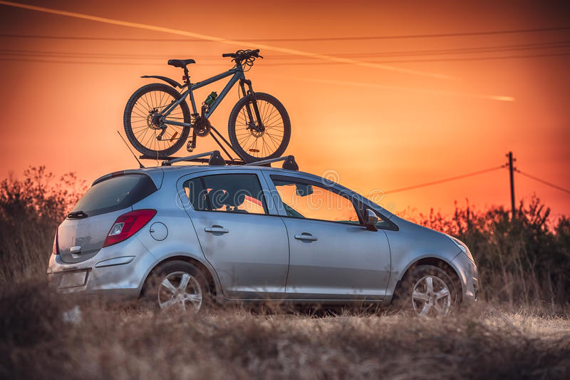 Car is transporting bicycle on the roof royalty free stock image