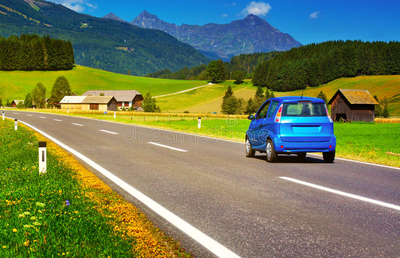 Car travel. Alps summer landscape stock photo