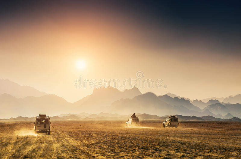 Car travel in the desert. Beautiful mountains in the Arabian desert at sunset stock photos