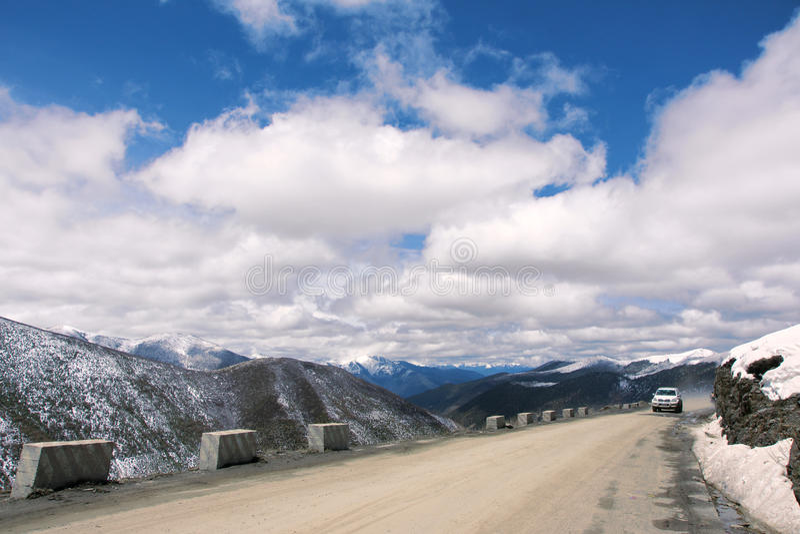Car travel. In Gaoersi Mountain in Sichuan, China stock image
