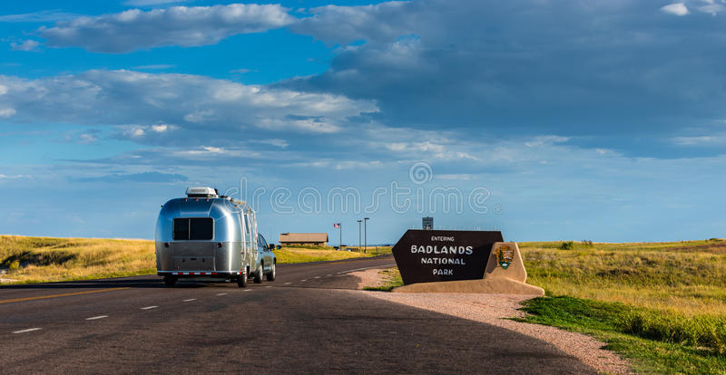 Car and Travel Trailer entering National Park stock image