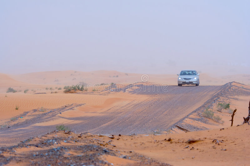 Car travelling across desert royalty free stock photo