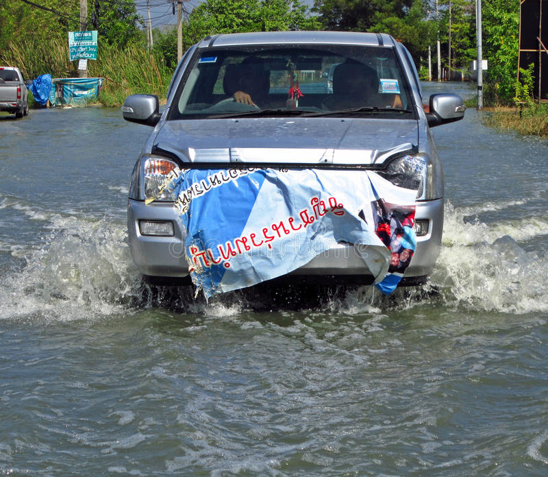 A Car Travels Through A Flooded Road Editorial Stock Image
