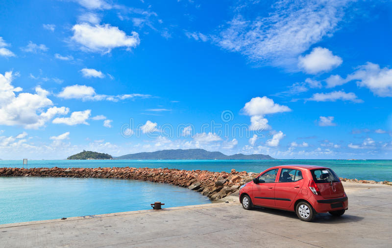 Car on tropical beach stock images