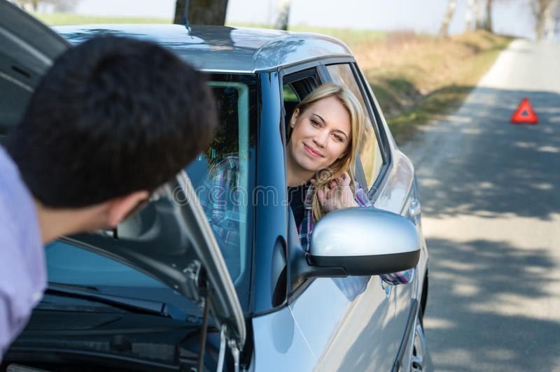 Car troubles man help woman defect vehicle. Car troubles men help women defect vehicle on the road royalty free stock photo
