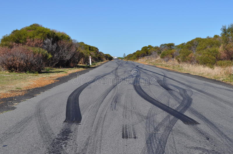 Car tyre tire skid marks on urban asphalt road stock images