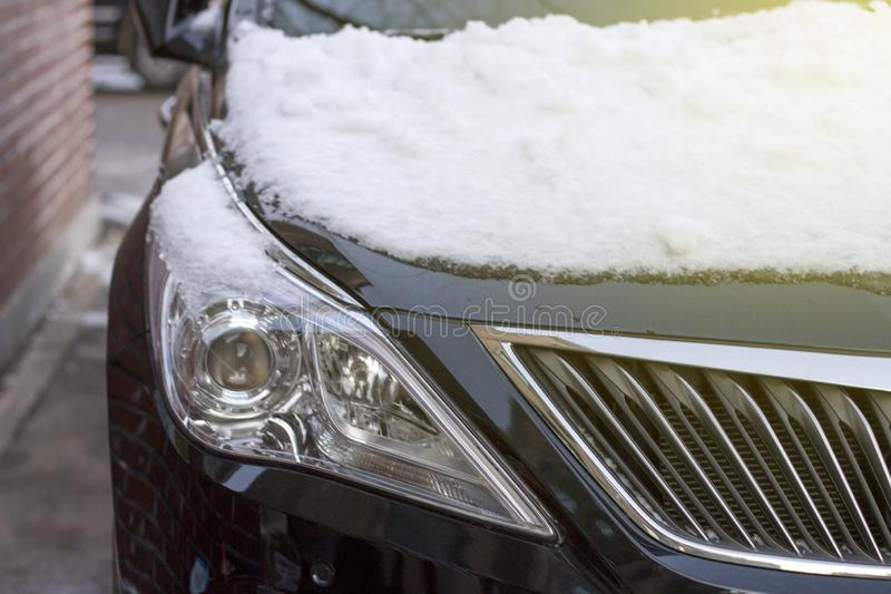 Car under the snow close-up front view royalty free stock photos