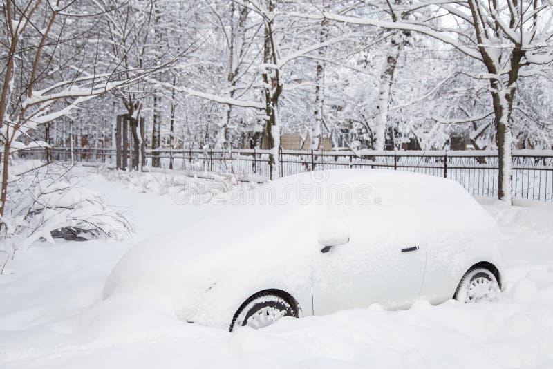 Car under snow stock photos