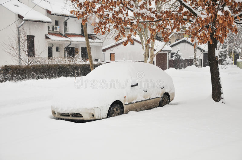 A car under the snow. In the street royalty free stock photos