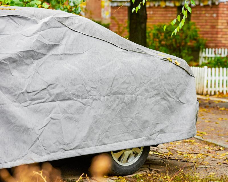 Car under tent. Closeup of car under protective cover from adverse weather conditions royalty free stock photography