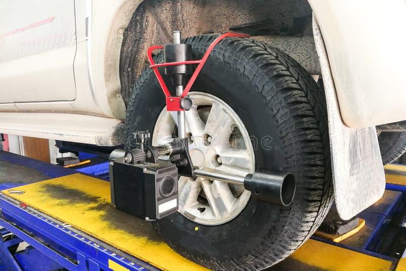 Car undergo wheel align in garage. With precision alignment equipment stock photos