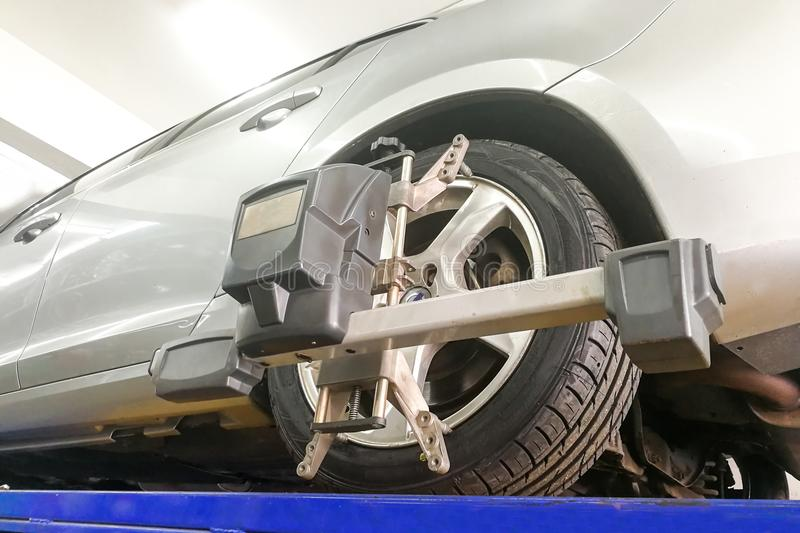 Car undergo wheel align in garage. With precision alignment equipment royalty free stock photos