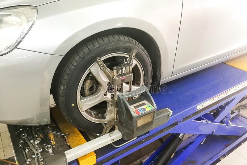 Car undergo wheel align in garage. With precision alignment equipment stock photo