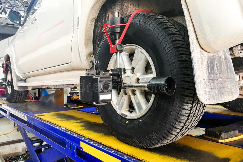 Car undergo wheel align in garage. With precision alignment equipment royalty free stock image