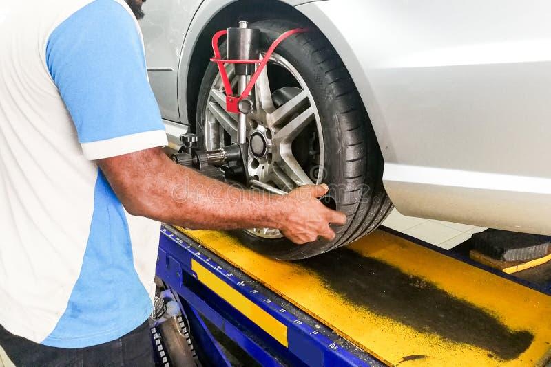 Car undergo wheel align in garage. With precision alignment equipment stock image