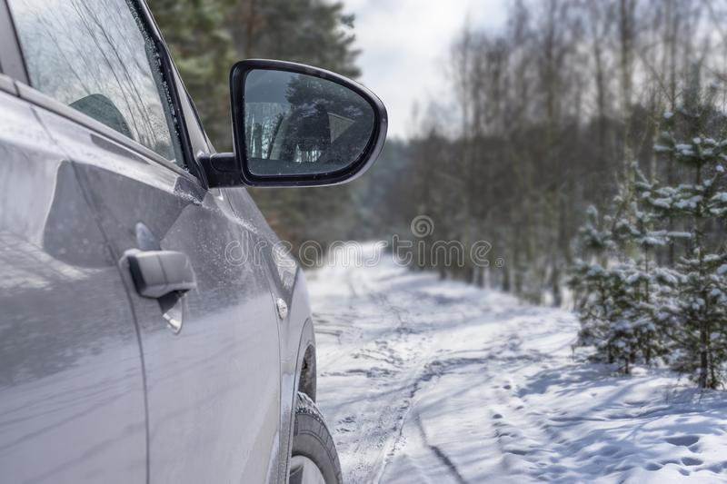 Car vehicle at snowy road in forest. Winter off road trip stock photo