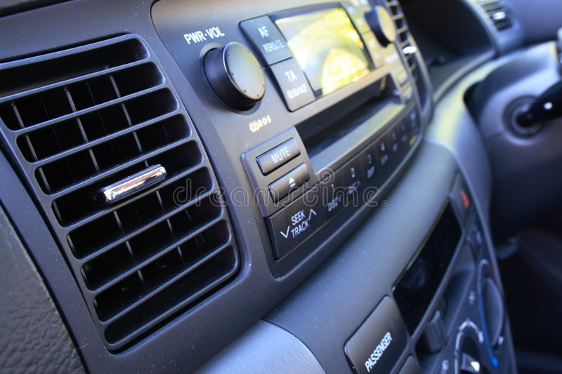 Car vent and radio. Close up view of car vent and radio stock photos