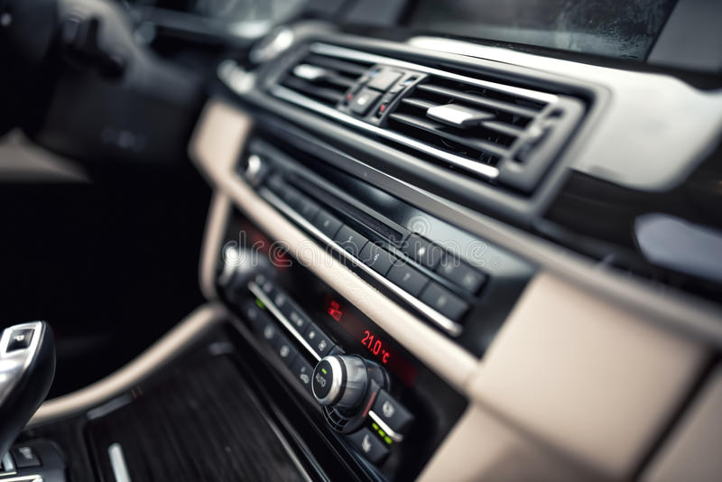 Car ventilation system and air conditioning - details and controls of car. Concept wallpaper with minimalist industrial des stock images