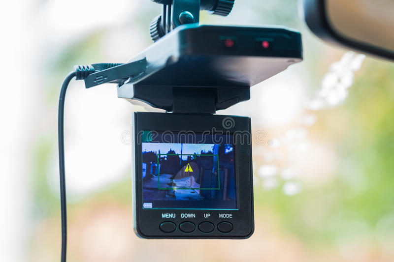 Car video recorder installed on a rear view mirror stock photo