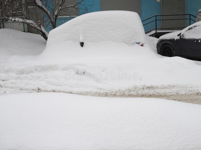 Car was so covered with snow that it turned into a snowdrift royalty free stock photography