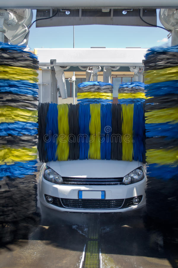 Car wash. White german car wash with soap and yellow and blu brushes stock photo