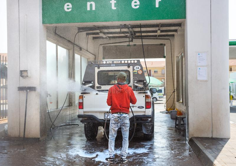 Car wash with attendant washing car stock photo
