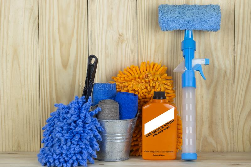Car wash equipment or car cleaning product such as microfiber tank and glass cleaner and brush with mitts and etc, on wooden tabl stock photos