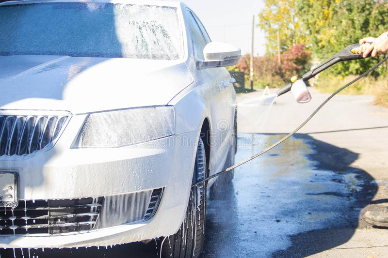 Car wash. car wash. man washes the car royalty free stock photo