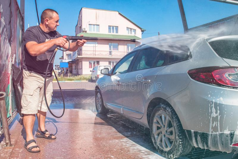 .Car wash self-service. The owner washes his car stock images