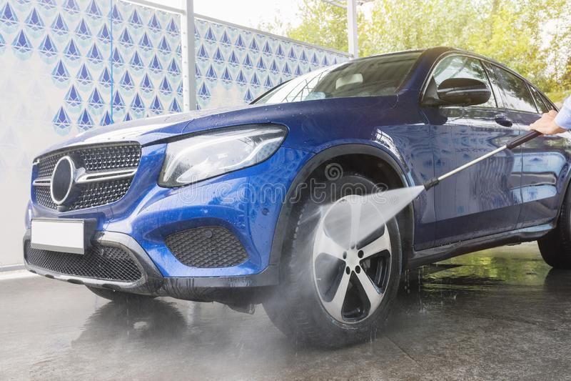 Car Washing. Cleaning Car Using High Pressure Water. Autowashing royalty free stock images
