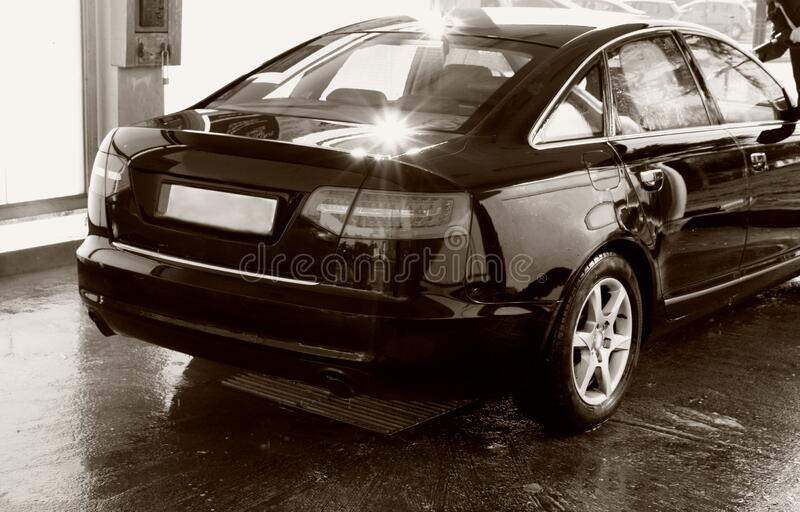 Car washing cleaning with hi pressured water. In b/w stock image
