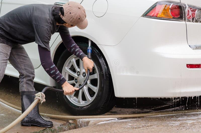 Car washing using high pressure water jet. stock photo