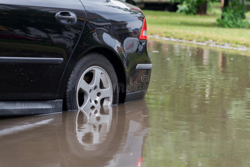 Car in water after heavy rain and flood royalty free stock images