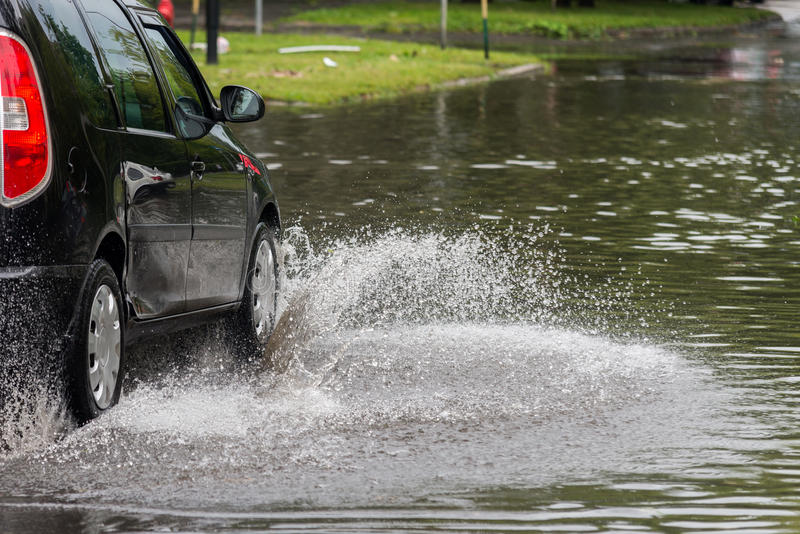 Car in water after heavy rain and flood stock image