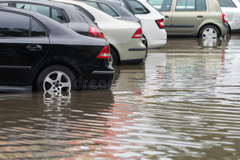 Car in water after heavy rain and flood stock photos