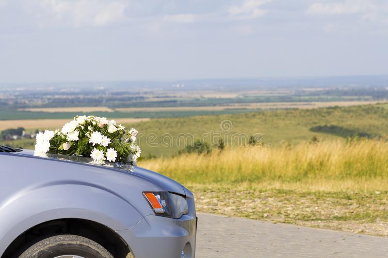 Car with wedding flowers on the hood royalty free stock images