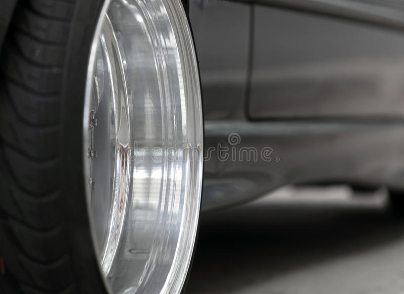 Car Wheel. Black and white image of a low profile car wheel stock photo