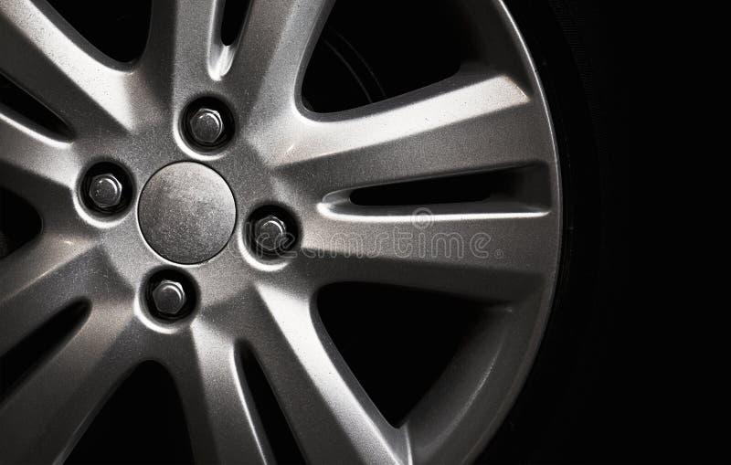 Car wheel. Silver car wheel in the dark background stock photos