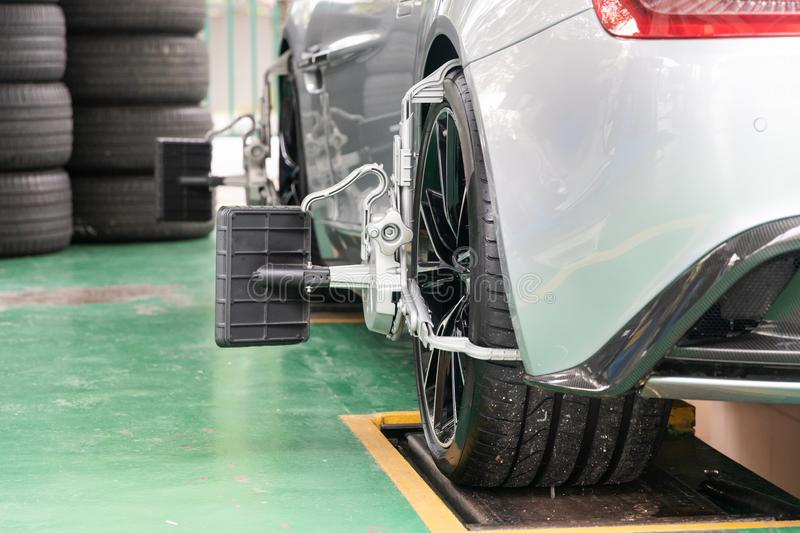 Car wheel clamp with wheel align device for wheel alignment. In workshop stock photos