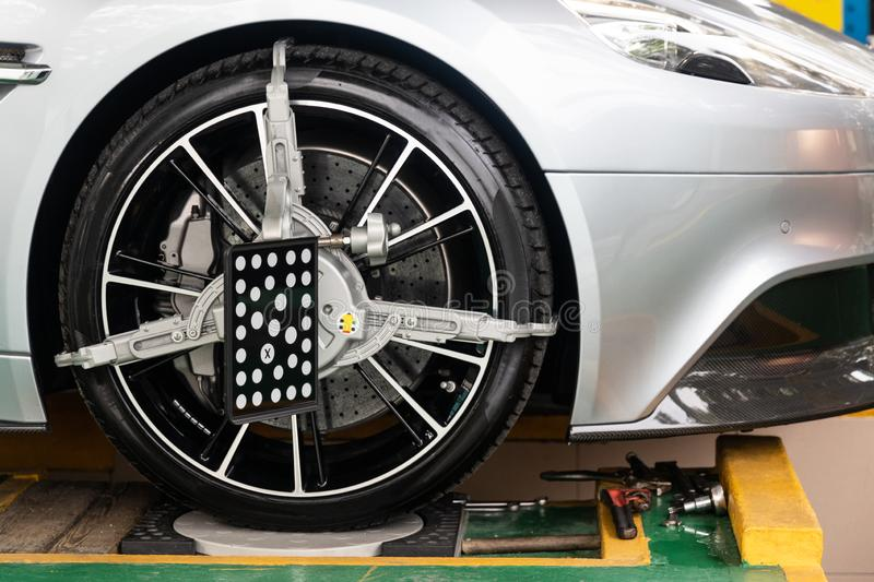 Car wheel clamp with wheel align device for wheel alignment. In workshop royalty free stock photos