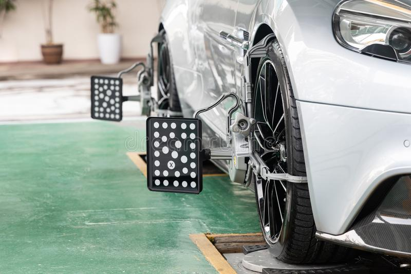 Car wheel clamp with wheel align device for wheel alignment. In workshop royalty free stock image