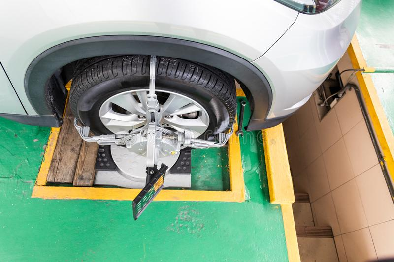 Car wheel clamp with wheel align device for wheel alignment. In workshop royalty free stock images