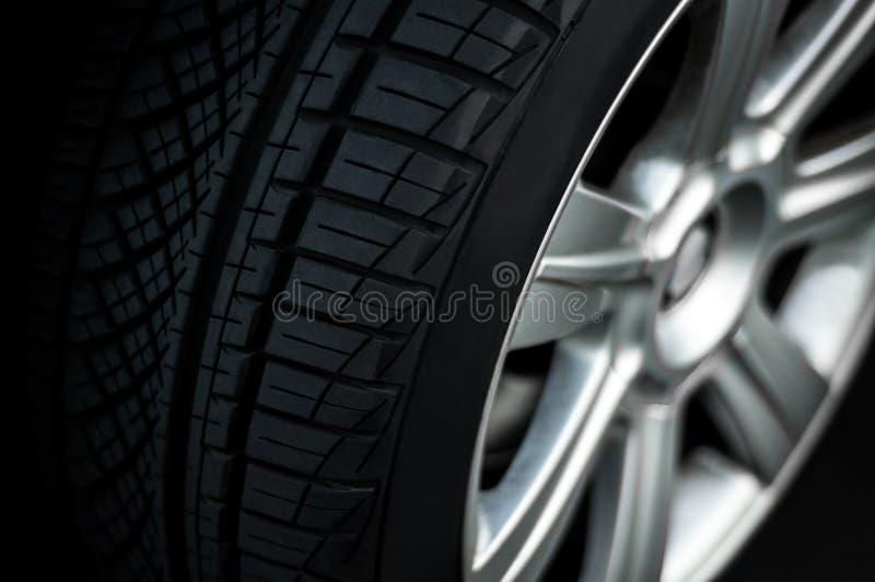 Car wheel. On a car, close-up, low key stock photo