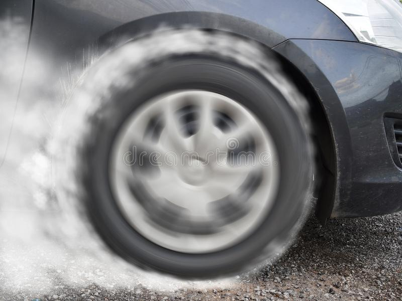 Car wheel drifting and smoking on track stock image
