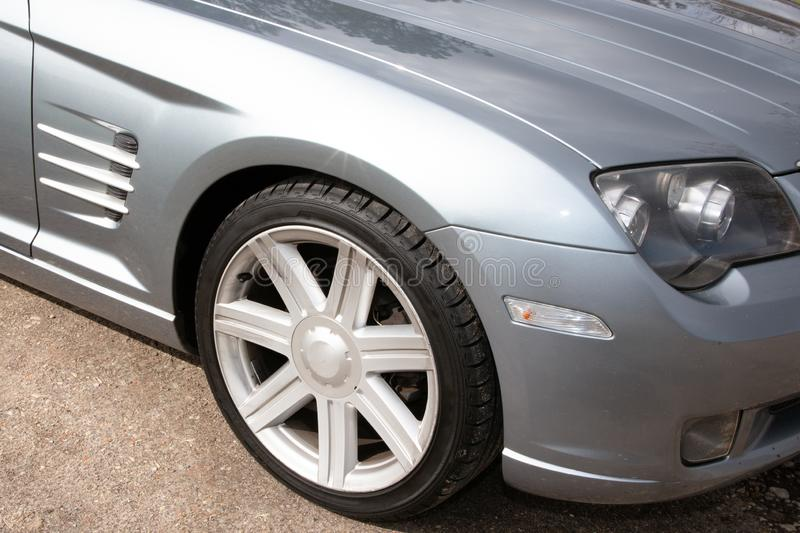 Car wheel rim front of gray sport automobile stock photography