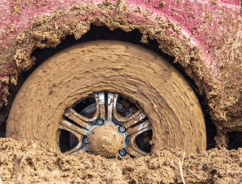 Car wheel slips in the dirt in nature.  royalty free stock photography