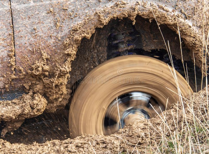 Car wheel slips in the dirt in nature.  stock photo