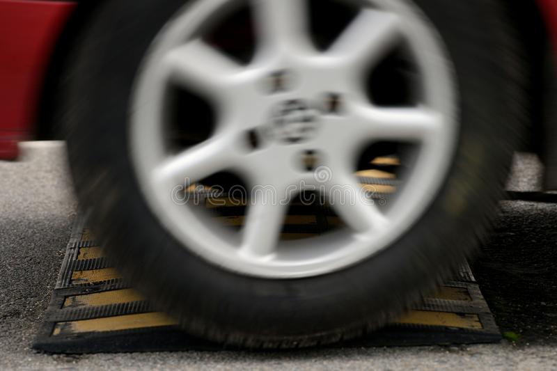 Car wheel and speed bumps closeup stock photography