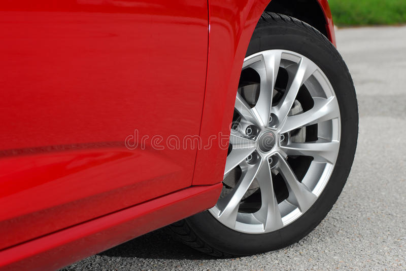 Car wheel. Tire and alloy wheel on this performance car royalty free stock photo