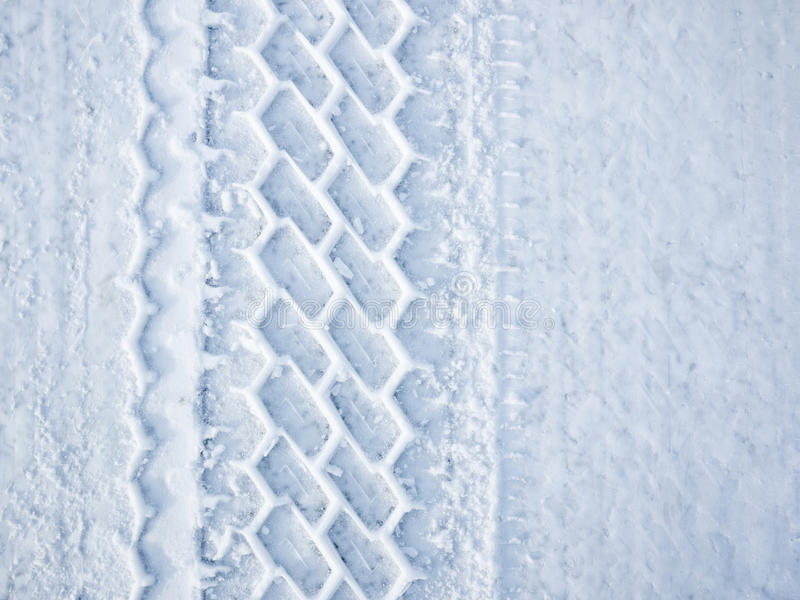 Car wheel track in snow royalty free stock photos